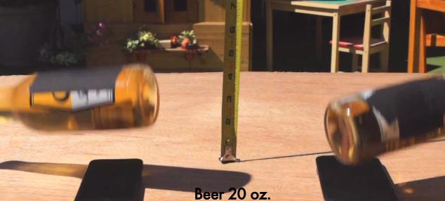 To flasker øl slippes fra 1 meters høyde. Hvem overlever - iPhone 5 eller Galxy SIII?